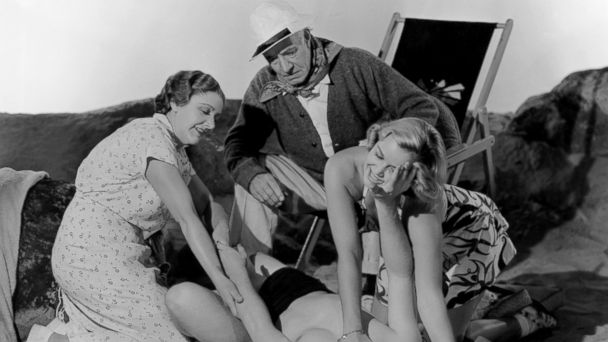 PHOTO: Fay Holden, Mickey Rooney, Lewis Stone, and Cecilia Parker enjoy a day at the beach in a scene from the film Youre Only Young Once.