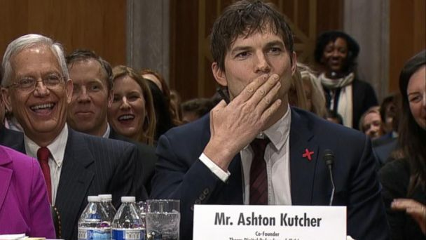 PHOTO: Actor Ashton Kutcher blows Sen. John McCain a kiss at the start of his testimony before a Senate Foreign Relations Committee hearing, Feb. 15, 2017, in Washington, DC.
