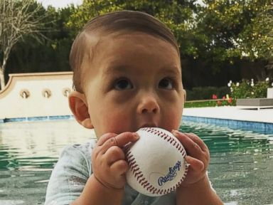 Boomer Phelps Hangs by the Pool With a New Toy