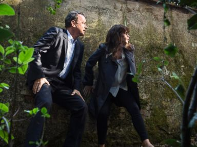 PHOTO: Tom Hanks as Robert Langdon and Felicity Jones as Sienna run for their lives through Boboli Gardens in Columbia Pictures Inferno.