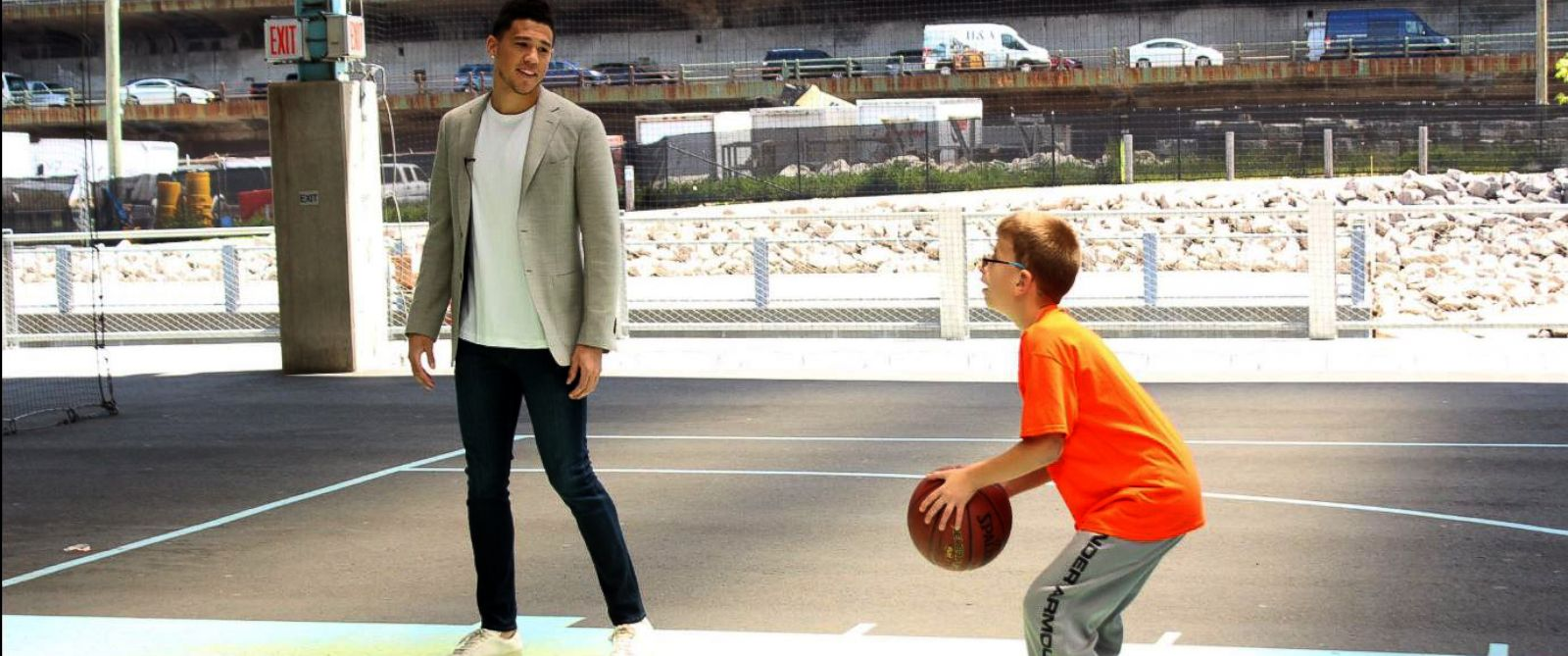 PHOTO: Devin Booker of the Phoneix Suns, left, coaching his Draft Lottery guest, Special Olympics athlete Noah.
