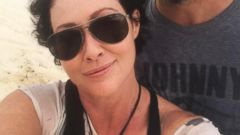 Curly-haired Shannen Doherty snaps a selfie with her husband