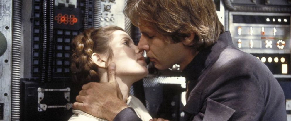 """PHOTO: Carrie Fisher as Princess Leia, left, and Harrison Ford as Han Solo in a scene from """"Star Wars: Episode V - The Empire Strikes Back."""""""