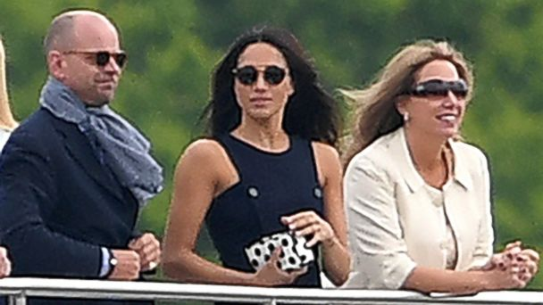 PHOTO: Meghan Markle watches with Mark Dyer, left, and wife Amanda Kline, right, as Prince Harry plays in the Audi Polo Challenge at Coworth Park Polo Club in Ascot, Berkshire, U.K, May 6, 2017.