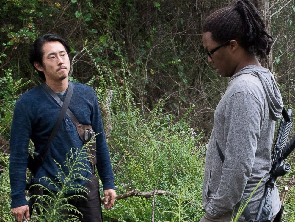 PHOTO: Steven Yeun as Glenn Rhee and Corey Hawkins as Heath on Season 6 of The Walking Dead.