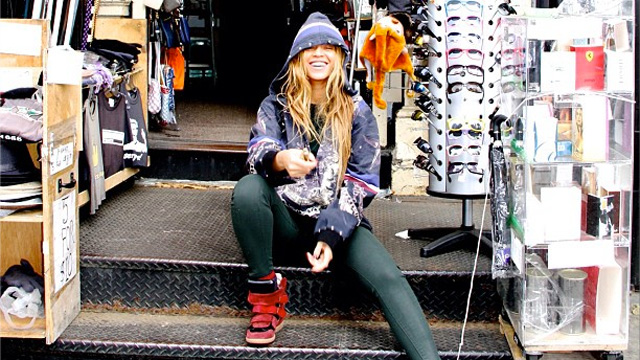 PHOTO: Beyonce posts a photo of herself at a street vendor, Spring 2013.