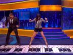 PHOTO: Sandra Bullock and Tom Hanks recreate the Chopsticks piano dance