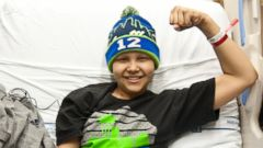 PHOTO: Seattle Childrens Hospital patient, Dane Bowman-Weston flexes for Strong Against Cancer, Jan. 27, 2015.