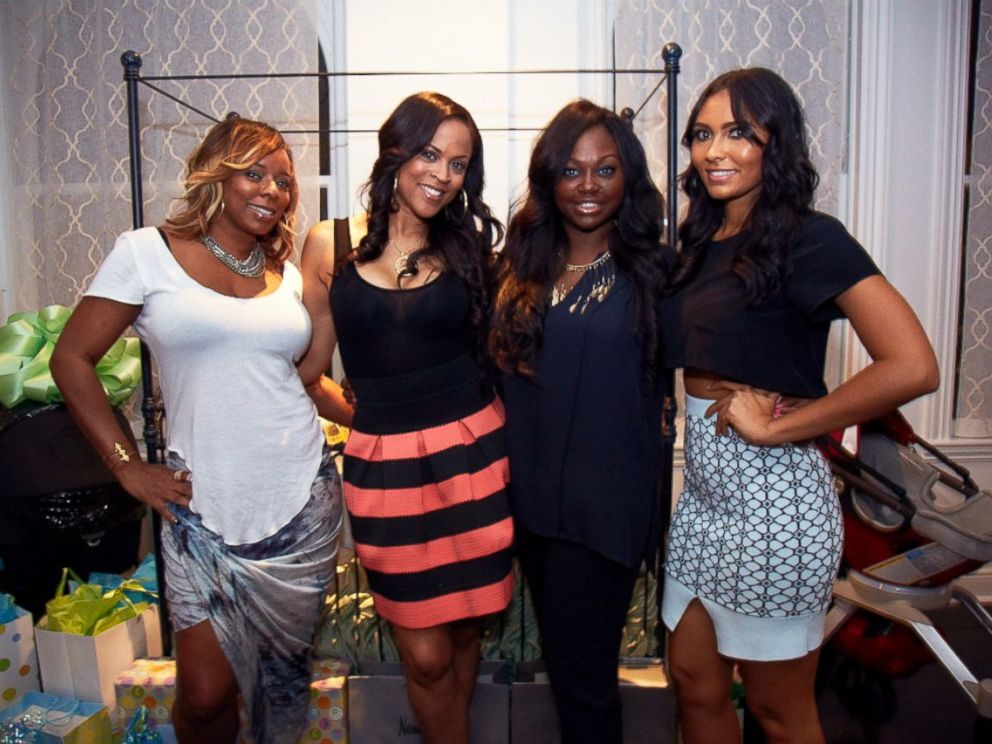 PHOTO: Evelyn Lozada poses with the hostesses of her baby shower.