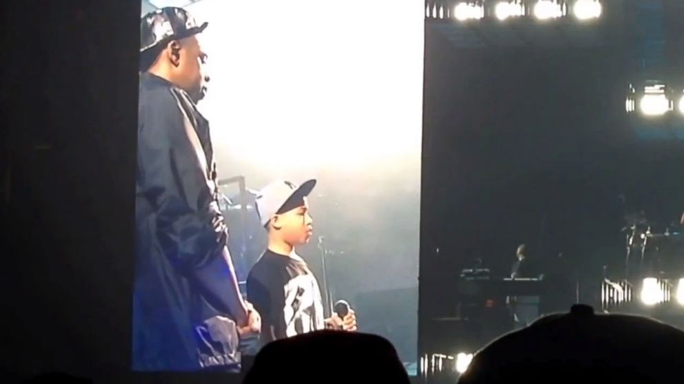 PHOTO: Jay Z hands the microphone to a 12-year-old boy at a concert in Greensboro, N.C., Jan. 5, 2014.
