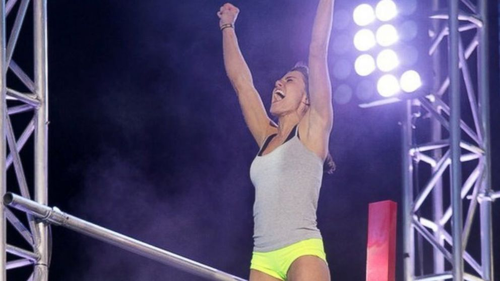 "PHOTO: Kacey Catanzaro celebrates after completing the ""American Ninja Warrior"" finals course."