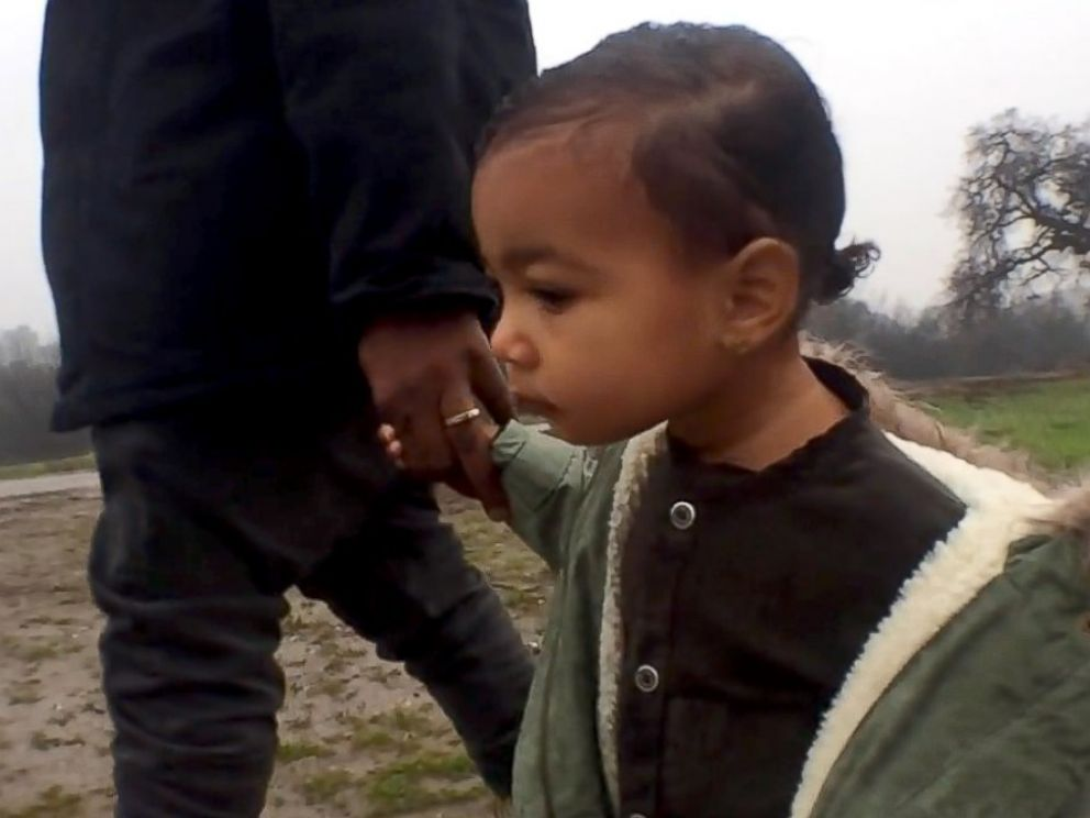 PHOTO: Kanye West gets intimate with his daughter North in his latest video for the song Only One.