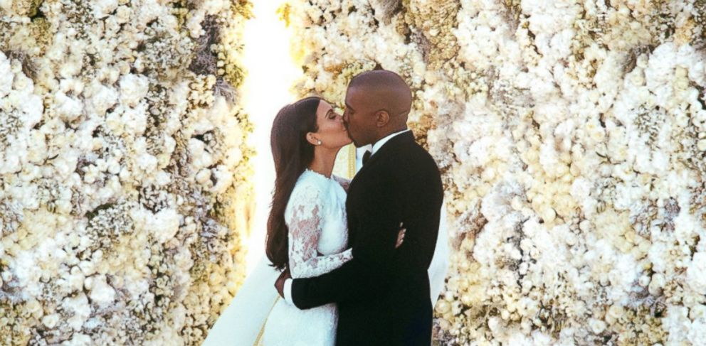 PHOTO: Kanye West and Kim Kardashian said I do at the Forte di Belvedere in Florence, Italy, May 24, 2014. <a href=http://www.eonline.com/news/545405/kim-kardashian-and-kanye-west-s-first-photos-as-a-married-couple-see-the-exclusive-pics-of-the-newlywe