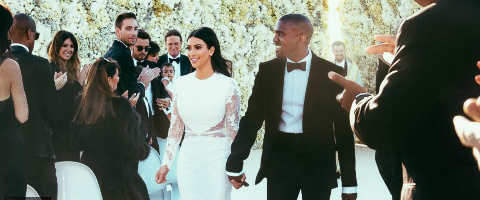 "PHOTO: Newlyweds Kanye West and Kim Kardashian walk down the aisle as friends and family look on at the Forte di Belvedere in Florence, Italy, May 24, 2014. <a href=""http://www.eonline.com/news/545405/kim-kardashian-and-kanye-west-s-first-photos-as-a-marr"