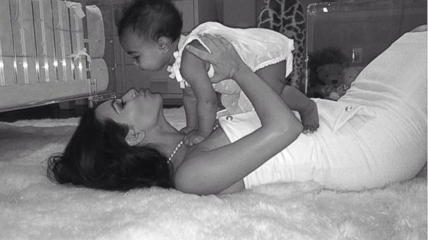 "PHOTO: Kim Kardashian posted this photo with this caption: ""This little girl has changed my world in more ways than I ever could have imagined! Being a mom is the most rewarding feeling in the world! Happy Mothers Day to all of the moms out there!"""