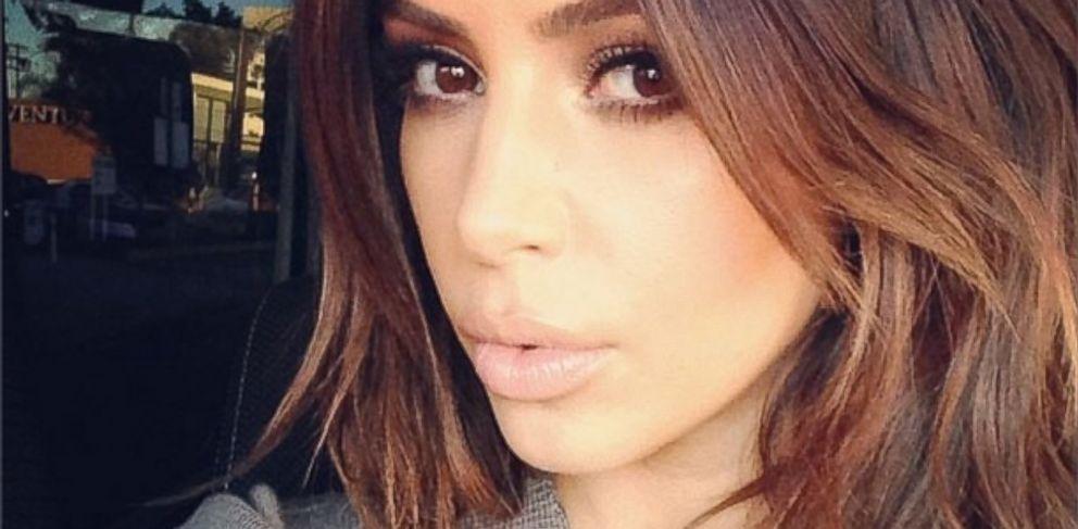 """PHOTO: Kim Kardashian says """"Im back"""" with a selfie, Feb. 1, 2014."""