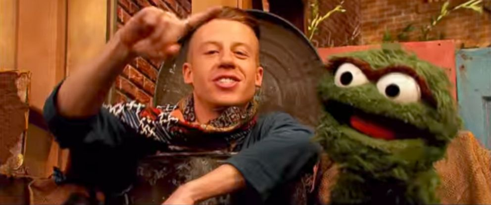 "PHOTO: Rapper Macklemore appears with Oscar the Grouch on a recent episode of ""Sesame Street."""