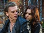 PHOTO: Lily Collins as Clary rides off with Jamie Campbell Bower as Jace in Screen Gems fantasy-action, The Mortal Instruments: City Of Bones.