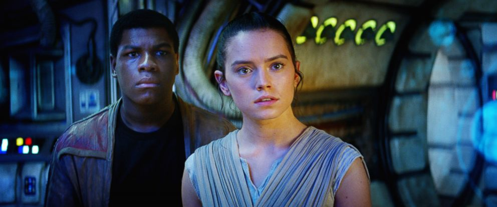 "PHOTO:John Boyega as Finn and Daisy Ridley as Rey in a scene from ""Star Wars: The Force Awakens."""