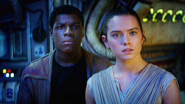 PHOTO:John Boyega as Finn and Daisy Ridley as Rey in a scene from