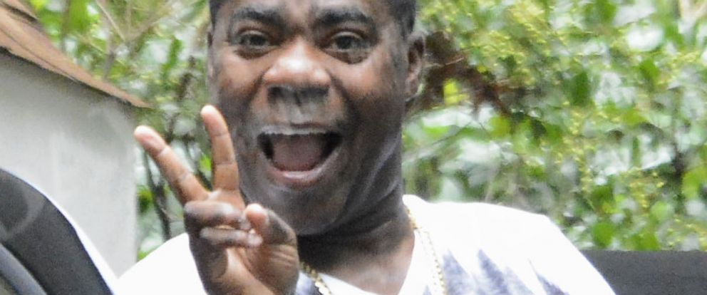 PHOTO: Tracy Morgan points his finger and smiles as he leaves his home in Cresskill, N.J, July 14, 2014. Morgan said he was ok and felt strong after the horrific car accident he was in.
