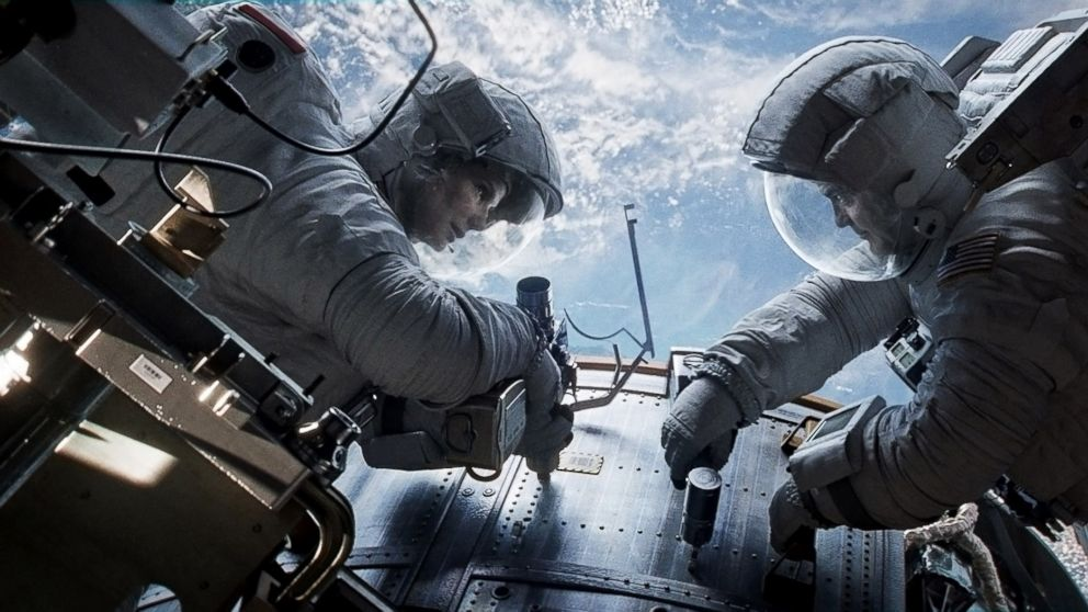 "PHOTO: Sandra Bullock, left, as Dr. Ryan Stone and George Clooney as Matt Kowalsky in ""Gravity."""
