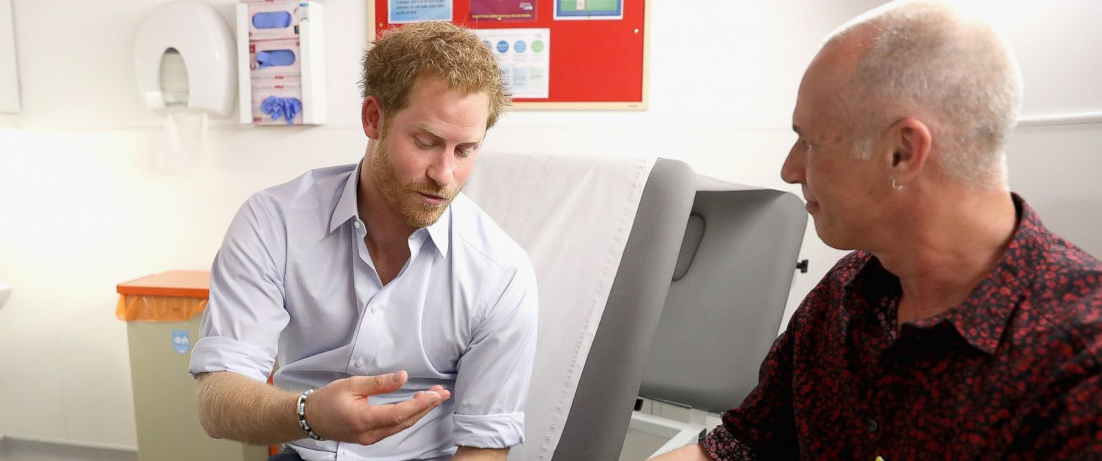 PHOTO: Prince Harry is shown the negative result of his HIV test taken by Specialist Psychotherapist Robert Palmer during a visit to Burrell Street Sexual Health Clinic on July 14, 2016 in London, England.