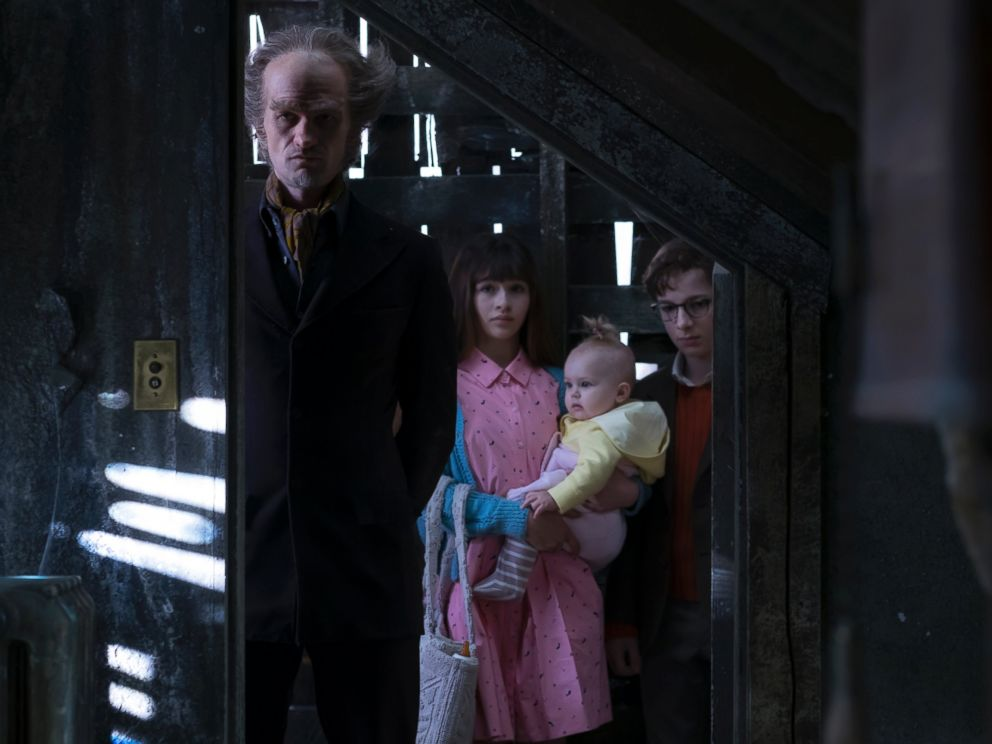 PHOTO: Neil Patrick Harris is pictured here in a still from the Netflix series A Series of Unfortunate Events as Count Olaf with co-stars Malina Weissman and Louis Hynes.