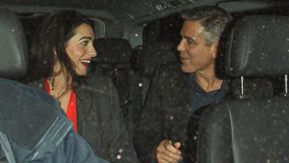 PHOTO: George Clooney and Amal Alamuddin leave Berners Tavern in London, Oct. 24, 2013.