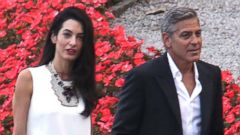 PHOTO: Actor George Clooney and fiancée Amal Alamudin step out for dinner in Italy, June 23, 2014.