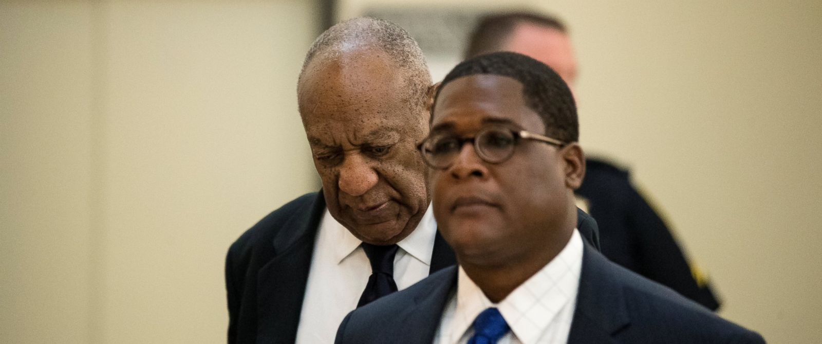 PHOTO: Bill Cosby walks to the courtroom with publicist Andrew Wyatt at the Montgomery County Courthouse as the jury deliberates in his sexual assault trial in Norristown, Penn., June 13, 2017