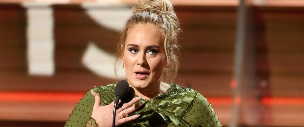 """PHOTO: Adele and co-song writer Greg Kurstin, not pictured, accept the Grammy for Song of the Year for """"Hello"""" at the 59th Annual Grammy Awards in Los Angeles, California, Feb. 12, 2017."""