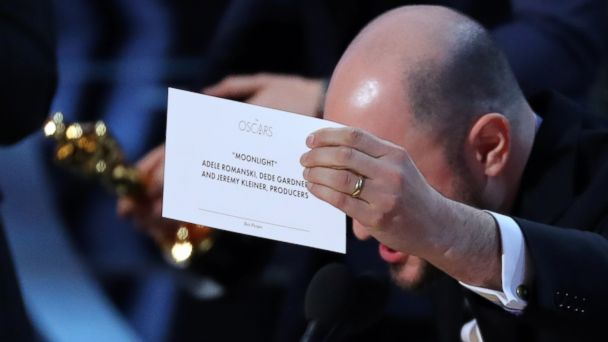 PHOTO: Producer Jordon Horowitz holds up the card for the Best Picture winner,