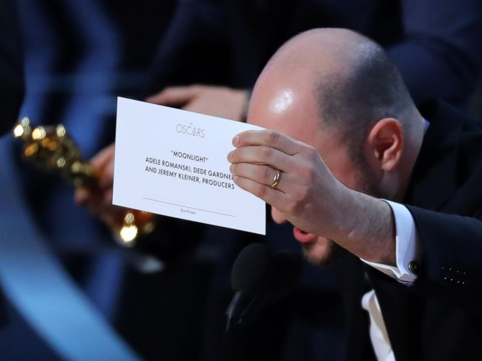 PHOTO: Producer Jordan Horowitz holds up the card for the Best Picture winner, Moonlight.
