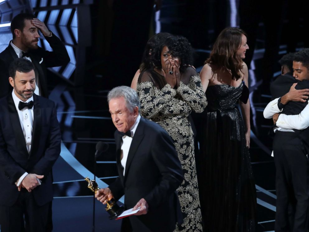 PHOTO: Members of the casts and crew from Moonlight react as presenter Warren Beatty announces that Moonlight won the Best Picture award at the 89th Academy Awards, Feb. 26, 2017.