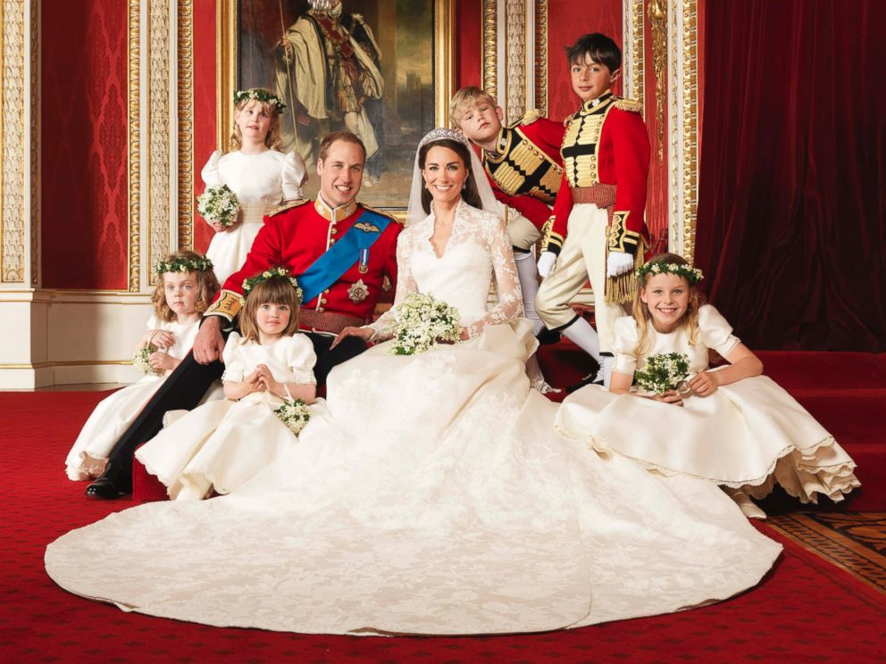 PHOTO: Britains Prince William and his bride Catherine, Duchess of Cambridge, pose for an official photograph, with their bridesmaids and pageboys, on the day of their wedding, in the throne room at Buckingham Palace, in central London, April 29, 2011.