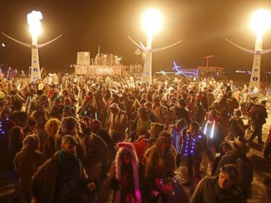 PHOTO: Participants dance at White Ocean during the Burning Man 2015 Carnival of Mirrors arts and music festival in the Black Rock Desert of Nevada, Sept. 4, 2015.