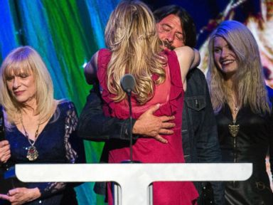 PHOTO: Courtney Love hugs drummer Dave Grohl of Nirvana