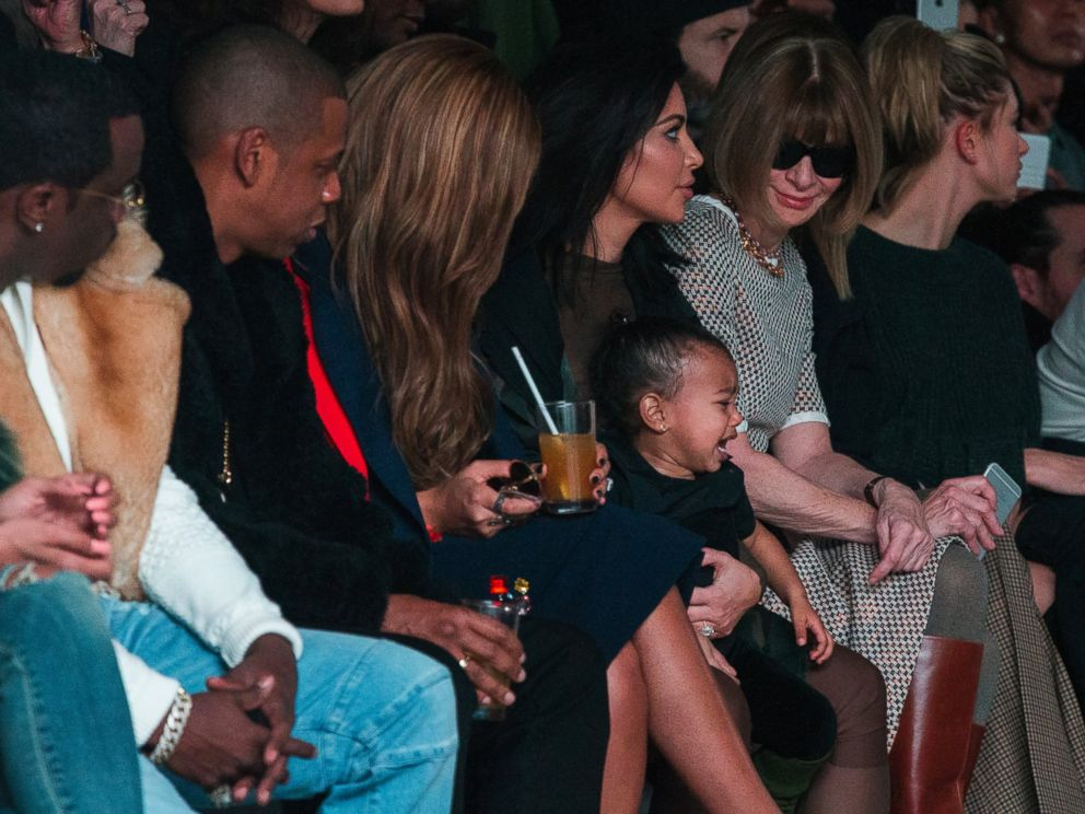 PHOTO: Kim Kardashian attempts to calm her daughter, North, while sitting next to Sean Combs Jay-Z Beyonce and Anna Wintour as they watch a presentation of Kanye Wests Fall/Winter 2015 partnership with Adidas at New York Fashion Week, Feb 12, 2015.
