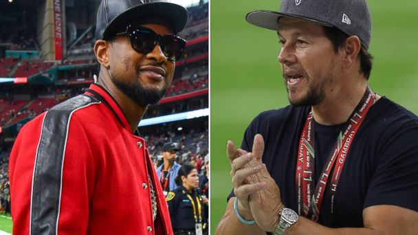 PHOTO: Usher (L) and Mark Wahlberg (R) on the field at Super Bowl LI between the Atlanta Falcons and the New England Patriot, Feb. 5, 2017 in Houston.