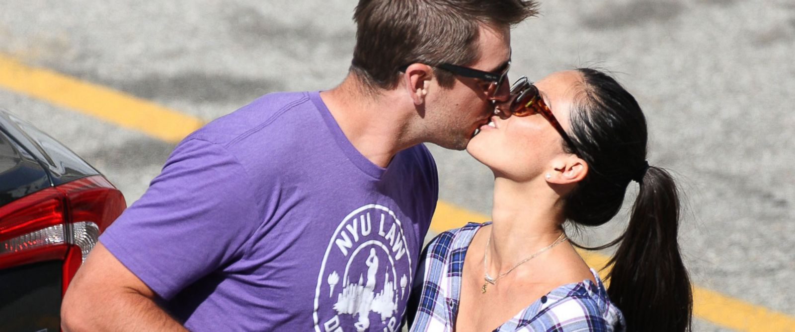PHOTO: New hot Hollywood couple Olivia Munn and football star Aaron Rodgers kiss as he visits her on the set of her hit HBO show the Newsroom shooting on location in Los Angeles,Ca.