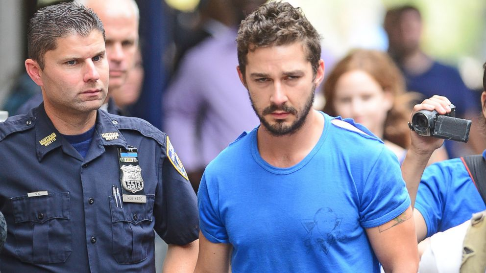 PHOTO: Shia LaBeouf is escorted by police while leaving court following his arrest in New York, June 27, 2014.