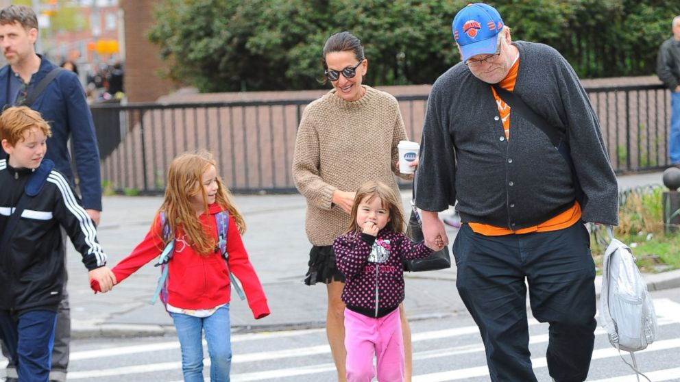 PHOTO: Philip Seymour Hoffman walks to school with his children, April 30, 2013, in New York City.