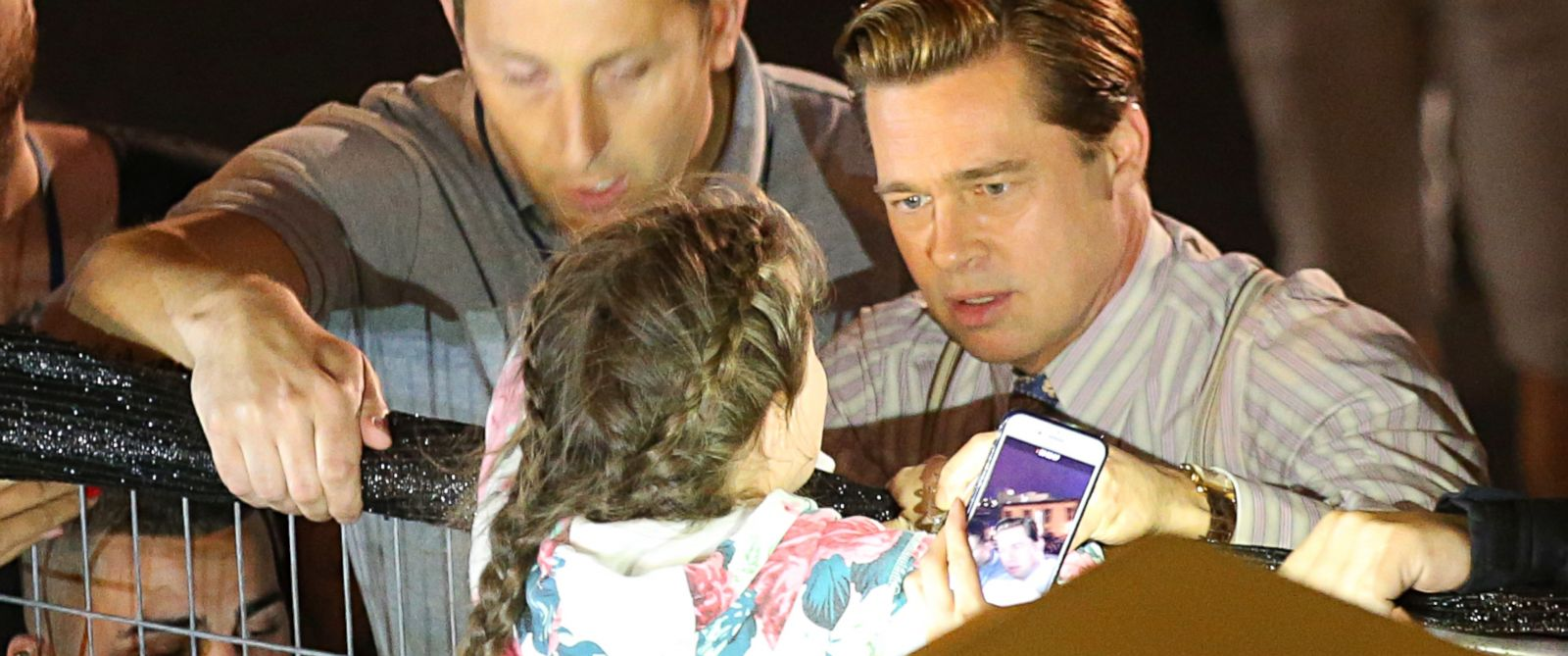 PHOTO: While filming scenes for the upcoming film Allied, Brad Pitt came to the rescue of a young girl who was in danger of getting crushed by the crowd waiting to see him on May 22, 2016.