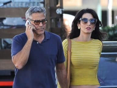 George and Amal Clooney Take a Walk On Set