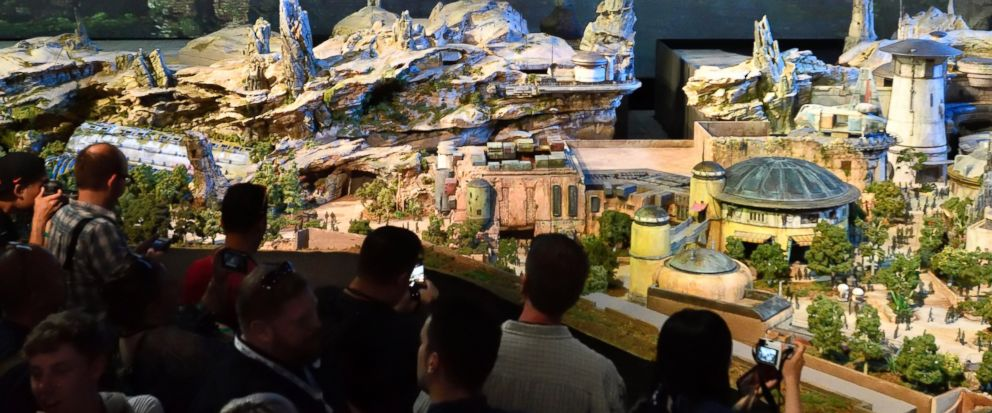 """Members of the media get their first look at a 50-foot, detailed model of """"Star Wars"""" land during a media preview for Disneys D23 Expo in Anaheim, Calf., on Thursday, July 13, 2017. (Jeff Gritchen/The Orange County Register via AP)"""