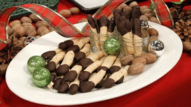 PHOTO: Chocolate-Dipped Pecan Shortbread Logs are shown here.