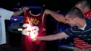VIDEO: Unhappy Cavaliers fans take to torching LeBron James paraphernalia.