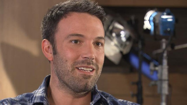 PHOTO: Ben Affleck talks with