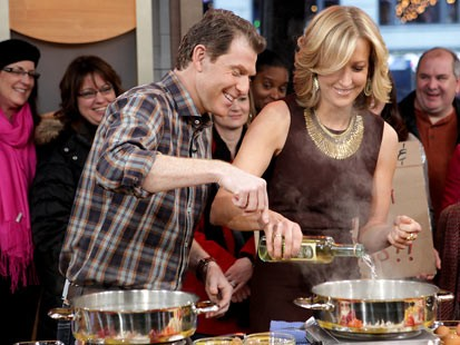 "PHOTO: Chef Bobby Flay instructs Lara Spencer on ""Good Morning America,"" Feb. 6, 2012."